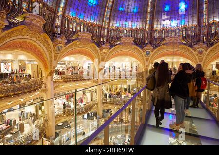 PARIS - NOVEMBER 6, 2019: Galeries Lafayette interior with Glasswalk installation and people and tourists in Paris