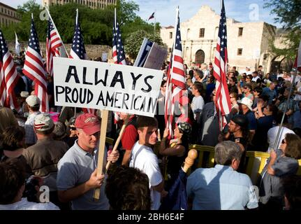 San Antonio, Texas April 15, 2009: Some of the thousands of Texans who gathered Wednesday in front of the Alamo in downtown San Antonio for a 'Tea Party' protesting federal bailouts and President Obama's economic and immigration policies.  The rally was highlighted by a renditon of the Star Spangled Banner by rocker Ted Nugent.          ©Bob Daemmrich - Stock Photo