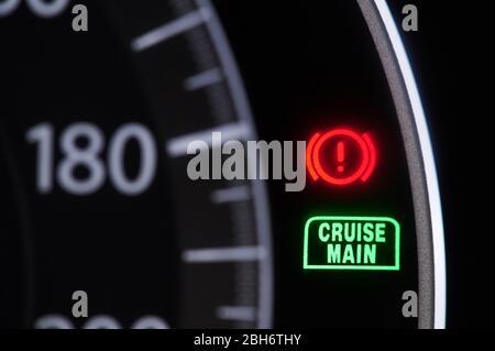 Macro of warning signs in car dashboard close up view