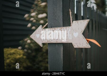 Wedding Arrow Sign hanging on a fence
