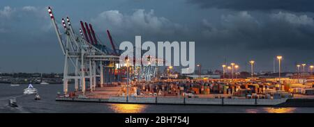 Container terminal in the port of Hamburg - Stock Photo