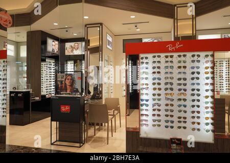 Dubai UAE December 2019 Sunglasses in a store. Sales rack of sunglasses. Prada, Dior, Roberto Cavalli, Ray Ban sunglasses. Close up of rows of sunglas