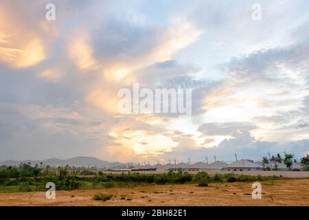 Photo of Twilight sky with many house's roofs in the morning day.