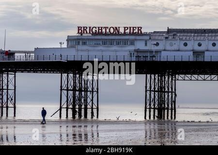 man alone at Brighton pier - Stock Photo