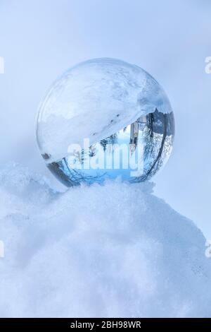 St. Barbara chapel in winter enclosed in a crystal ball, Tolpei, La Valle - Wengen, Val Badia, Bolzano, Dolomites, South Tyrol, Italy - Stock Photo