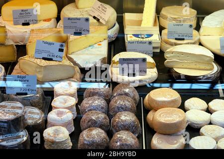 France, Alsace, Alsace Wine Route, Colmar, Market, Market Hall, Marche couvert de Colmar, Permanent Regional Market, Cheese Stand, Cheeses, Detail - Stock Photo