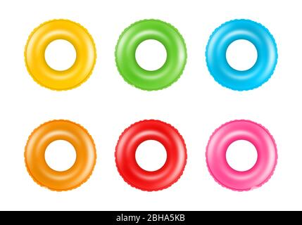 Set of colorful swimming rings. Collection of inflatable rubber rings. Floating summer toys. - Stock Photo