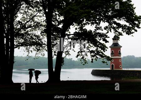Moritzburg: Lighthouse with jetty at pond Großteich, rain, people with umbrella in, Sachsen, Saxony, Germany - Stock Photo