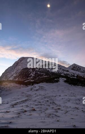 Austria, Salzburg state, Salzburg, Hagengebirge, view from the Cal von Stahl house on the moon above the snowy Schneibstein - Stock Photo
