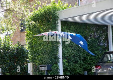 Avalon Beach, Sydney, Australia. Saturday 25th  April  2020, With traditional ANZAC Day marches and parades cancelled across Australia due to COVID-19 risks, many Sydney residents are celebrating ANZAC Day at home displaying national flags and Lest We Forget crosses at the end of driveways. Credit Martin Berry/Alamy Live News - Stock Photo