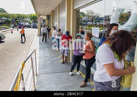 Apr. 1, 2020 - Several people lined up to enter a supermarket in the capital of El Salvador during the established quarantine. - Stock Photo