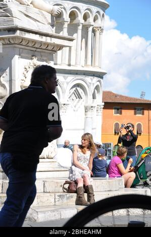 TOURISTS PISA LEANING TOWER - Stock Photo