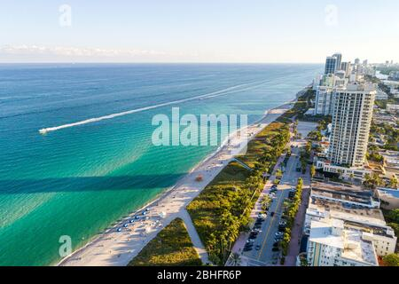 Florida Miami Beach Atlantic Ocean public aerial overhead bird's eye view above North Beach sand water surf high rise residential condominium building