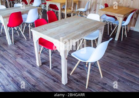 Wooden table and chairs plastic - Stock Photo