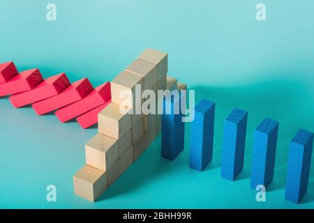 Concept of covid19 coronavirus pandemic with falling chain like a domino game. Contagion and infection progression stopped by a wall of brick. Cyan