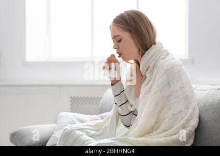 Sick young woman coughing at home, empty space - Stock Photo
