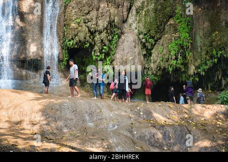 Tenasserim Hills, Sai Yok District of Kanchanaburi Province, Thailand 12.28.2019: Local Thai children and their parents relaxing, playing and enjoying - Stock Photo