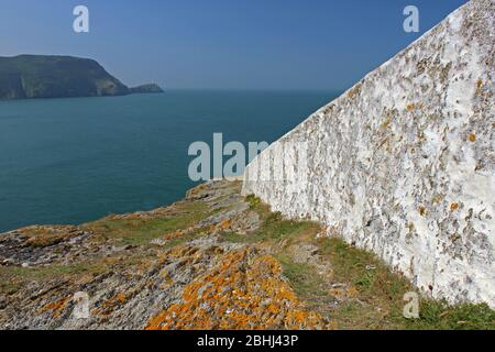 Views from North Stack headland towards lighthouse on Anglesey, Wales - Stock Photo