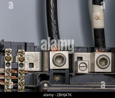 Wiring in electrical circuit breaker box panel with bus bar and copper wires. Concept of home maintenance, repair, remodeling - Stock Photo