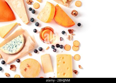 Cheese and wine tasting and pairing flat lay on a white background with a place for text. Many different cheeses, shot from above - Stock Photo