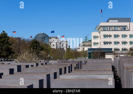 Holocaust Memorial in front of the American Embassy and the Reichstag building - Stock Photo