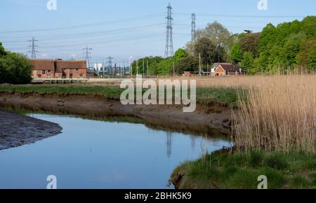 View of Eling Tide Mill grade II listed building  looking across Bartley Water, Eling, Totton, Hampshire, England, UK - Stock Photo