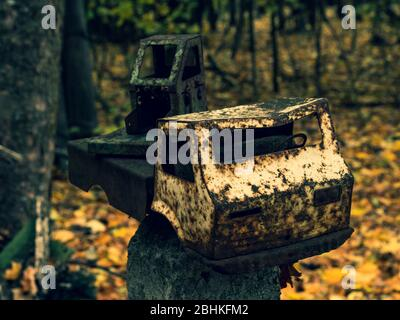 Broken rusty toy truck on fence post at abandoned kindergarten in Chernobyl Exclusion Zone