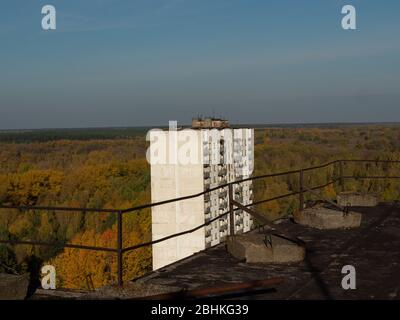 View from roof of ghost town Pripyat, post apocalyptic city, autumn season in Chernobyl exclusion zone, Ukraine - Stock Photo