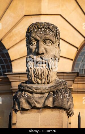 Carved stone head of an Emperor outside the Sheldonian Theatre, Oxford, UK - Stock Photo