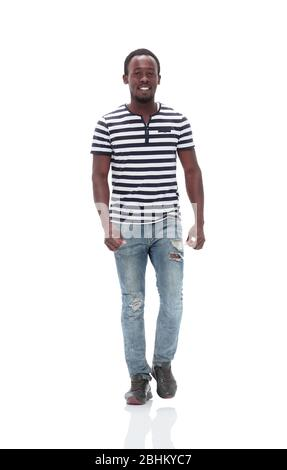 stylish young man confidently stepping forward . isolated on white - Stock Photo
