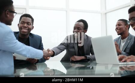 business people greeting each other during a working meeting.