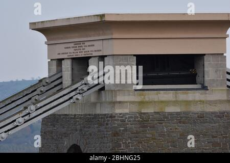 The writing on the top of one of the towers on Clifton Suspension Bridge in Bristol, England, UK - Stock Photo