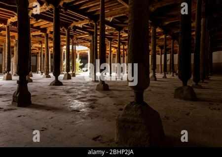 Khiva, Uzbekistan - June 5, 2019: Interior of Juma mosque with wooden pilars in the centre of the old town of Khiva in Uzbekistan. - Stock Photo