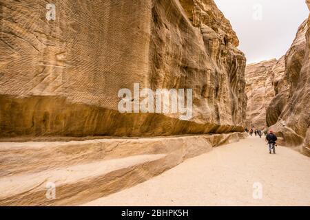 pedestrians in a canyon at Petra, Jordan - Stock Photo