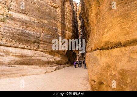 tourists walking in a revine at Petra, Jordan - Stock Photo