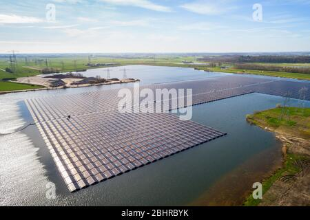 Aerial view of solar panels set on a lake in the countryside. - Stock Photo