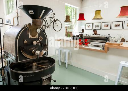 Johannesburg, South Africa - January 14, 2013: Old school machinery used to roast coffee beans - Stock Photo