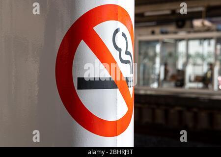 Japan, close up, No smoking sign on the pole at the train station platform - Stock Photo