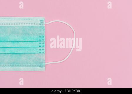 Face shield, FFP1 NR level . Protection against, bacteria, COVID-19, viruses, coronavirus. medical face mask N95 isolated on pink background - Stock Photo