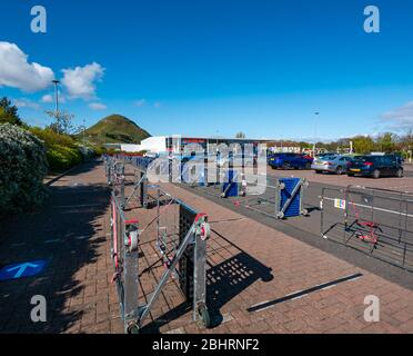 Barriers made from delivery trolleys in carpark of Tesco suppermarket to create safe social distancing barriers for shoppers to queue, North Berwick, Scotland, UK - Stock Photo