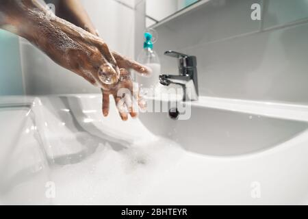 Female washing hands with liquid soap for preventing and stop corona virus spreading - Hygiene and healthcare people concept