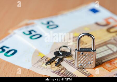 Lock and key on euro banknotes representing concept of financial control in the European Union. The economic future of Europe after the covid-19 crisi