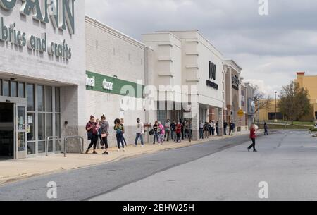Berks County, Pennsylvania, USA, April 26, 2020- People social distancie while waiting in a long line to enter Joann Fabric. - Stock Photo
