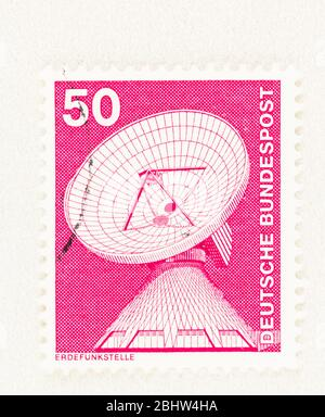 SEATTLE WASHINGTON - April 26, 2020:  1975 Stamp featuring dish aerial at Raisting Satellite Earth Station in Germany, issued as part of the Industry - Stock Photo