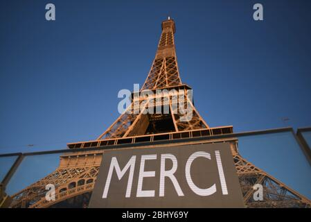*** STRICTLY NO SALES TO FRENCH MEDIA OR PUBLISHERS - RIGHTS RESERVED ***April 26, 2020 - Paris, France: A message related to the Covid-19 crisis on the Eiffel tower, which has been closed because of the lockdown. The word 'merci' means 'thank you' in French. Un message de remerciement lie a la crise sanitaire du coronavirus sur la tour Eiffel, qui a ete fermee pour la duree du confinement. - Stock Photo