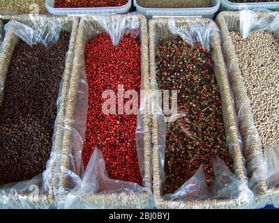 Various sorts of peppercorns on market stall in Edenbridge Kent - - Stock Photo