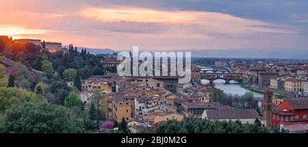 Panoramic view of Florence at sunset with in the background, the Basilica di Santo Spirito (English: Basilica of the Holy Spirit) and its spire, the C - Stock Photo