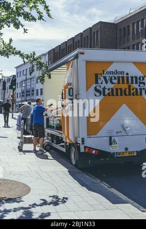 London/UK-1/08/18: man unloading the London Evening Standard at The Quadrant in Richmond. The Evening Standard is a local, free daily newspaper, publi - Stock Photo
