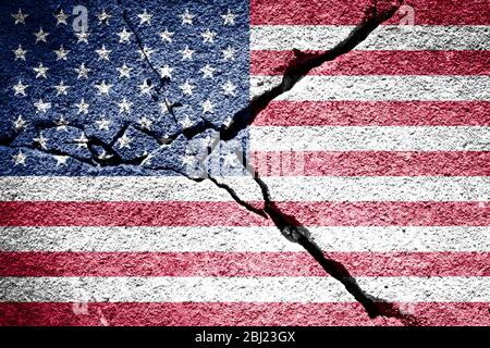 USA flag on cracked concrete wall. The concept of crisis, default, economic collapse, pandemic, conflict, terrorism or other problems in the country.
