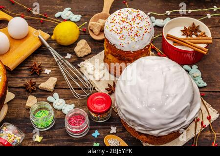 Easter cake decoration. Icing-sugar, topping, edible beads. Natural healthy ingredients, vintage wooden table